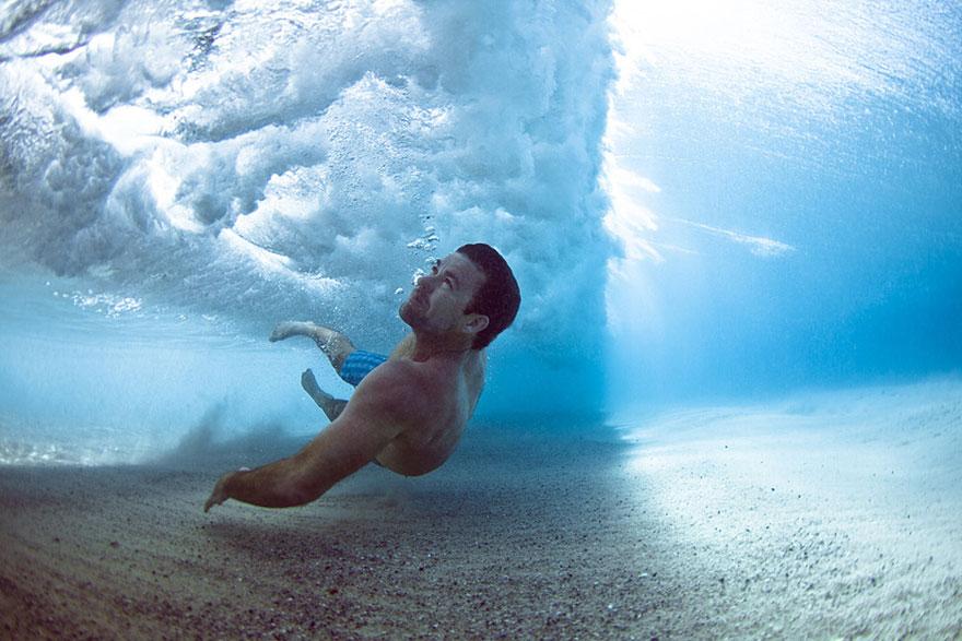 Stunning Underwater Photos of People Fighting Against the Ocean