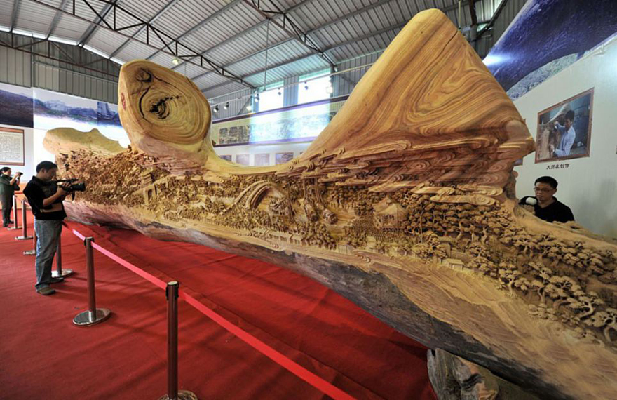 Chinese Sculptor Spends Years Sculpting Worlds Longest Wooden - Artist spends year woods creating beautiful sculptures