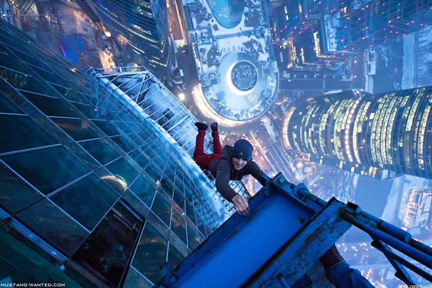 Dizzying Photos of Ukrainian Daredevil Hanging from Tall Buildings